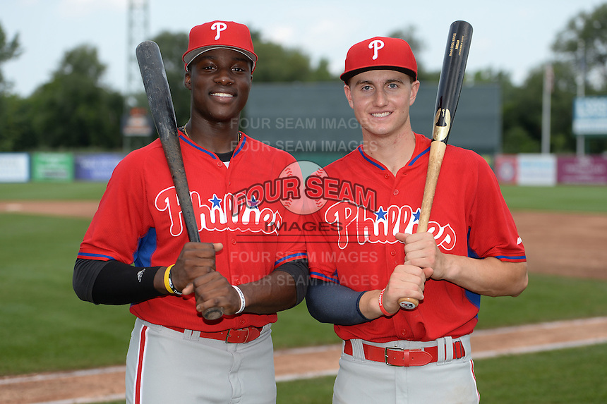 Demi Orimoloye (45) of St. Matthews Catholic High School in Orleans, Ontario, Canada and John Aiello (46) of Germantown Academy in Lansdale, Pennsylvania pose for a photo while playing for the Philadelphia Phillies scout team during the East Coast Pro Showcase on August 1, 2014 at NBT Bank Stadium in Syracuse, New York.  (Mike Janes/Four Seam Images)