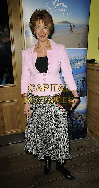 "MAUREEN LIPMAN.Attending Kathy Lette's ""To Love, Honour and Betray"" book launch party, London, England. .September 24th 2008.full length pink jacket print skirt black white bag boots.CAP/CAN.©Can Nguyen/Capital Pictures."