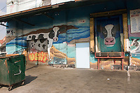 (040826-SWR051) New York, NY - 26 August 2004 - Cow murals adorn the facade of this meat processing facility in Gansevoort Market, the Meat Packing District.