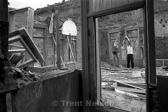 Alex Van Valin (white shirt) and Scott Hubert playing basketball in the ruins of the Thistle Schoolhouse.   &amp;#xA;<br />