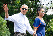 United States President Barack Obama waves to the assembled press as he and first lady Michelle Obama depart the White House in Washington, DC on Saturday, August 6, 2016 to travel to Martha's Vineyard, Massachusetts for their annual two week vacation.  <br /> Credit: Ron Sachs / Pool via CNP