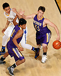 RAPID CITY, S.D.-- MARCH 21, 2015:  Jeremiah Hopkins #12 of Little Wound watches as Lattrel Terkildsen #11 and Brendan Harter #53 of Winner chase a loose ball during their game at the 2015 South Dakota  State A Boys Basketball Tournament at the Don Barnett Arena in Rapid City Saturday. (Photo by Dick Carlson/Inertia)