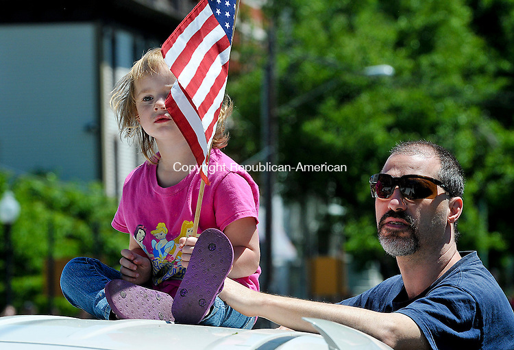 WINSTED, CT 27 MAY 2013--052713JS11-Crystal Hubbard, 3, of Winsted, watches the annual Winsted Memorial Day parade with her grandfather Darren Marciano on Monday. .Jim Shannon Republican American