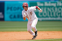 Tyler Holt #15 of the Florida State Seminoles takes off for third base against the North Carolina State Wolfpack during the Championship Game of the 2010 ACC Baseball Tournament at NewBridge Bank Park May 30, 2010, in Greensboro, North Carolina.  The Seminoles defeated the Wolfpack 8-3.  Photo by Brian Westerholt / Four Seam Images