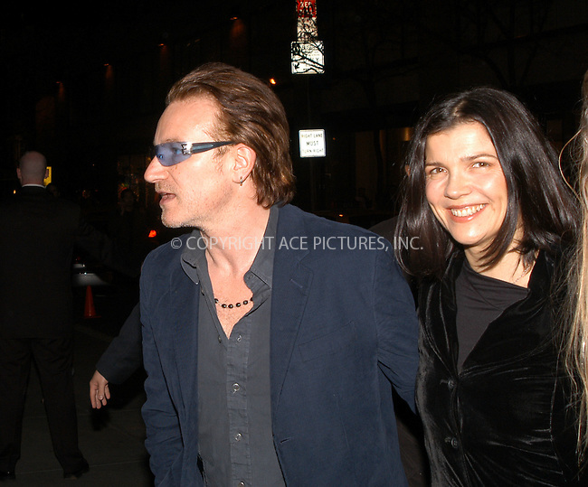 U2's Bono and girlfriend auctioned artwork from his interpertation of 'Peter and the Wolf'  to benefit the Irish Hospice Foundation at Christie's, New York City. November 21 2003. Please byline: AJ SOKALNER/NY Photo Press.   ..*PAY-PER-USE*      ....NY Photo Press:  ..phone (646) 267-6913;   ..e-mail: info@nyphotopress.com