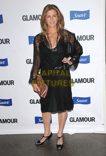 RITA WILSON.The Glamour Reel Moments held at The DGA in West Hollywood, California, USA. .October 14th, 2008                                                                     .full length black dress sheer sleeves belt pink clutch bag t-bar shoes hand on hip .CAP/DVS.©Debbie VanStory/Capital Pictures.