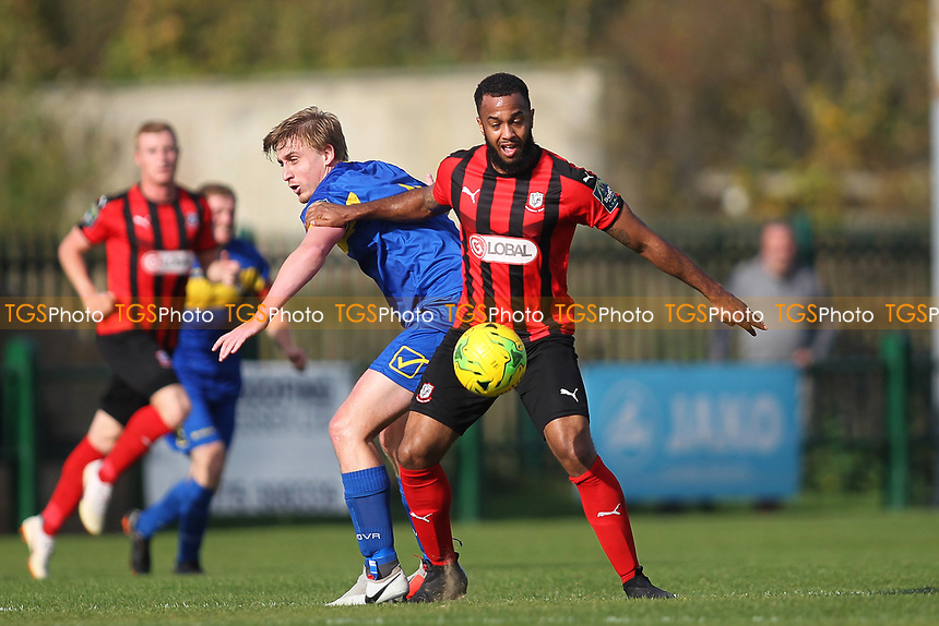 Max Bradford of Romford and Syrus Gordan of Coggeshall during Romford vs Coggeshall Town, Bostik League Division 1 North Football at Rookery Hill on 13th October 2018