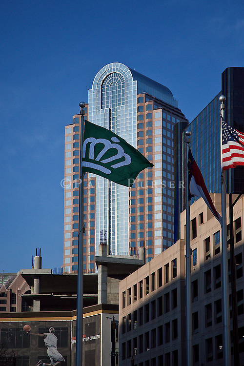 Charlotte NC - Queen City Flag in front of a skyscraper in uptown