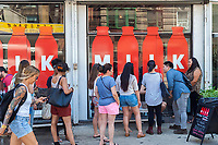 Customers outside the Milk pop-up store in New York on Saturday, June 24, 2017. Milk, a California based company, opened a pop-up store in New York selling their products including macaron ice cream sandwiches as a branding event to promote the new distribution of their ice cream in supermarkets. (© Richard B. Levine)