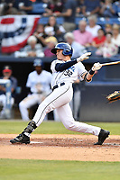 Asheville Tourists Luke Morgan (32) swings at a pitch during a game against the Lexington Legends at McCormick Field on July 3, 2019 in Asheville, North Carolina. The Tourists defeated the Legends 10-6. (Tony Farlow/Four Seam Images)