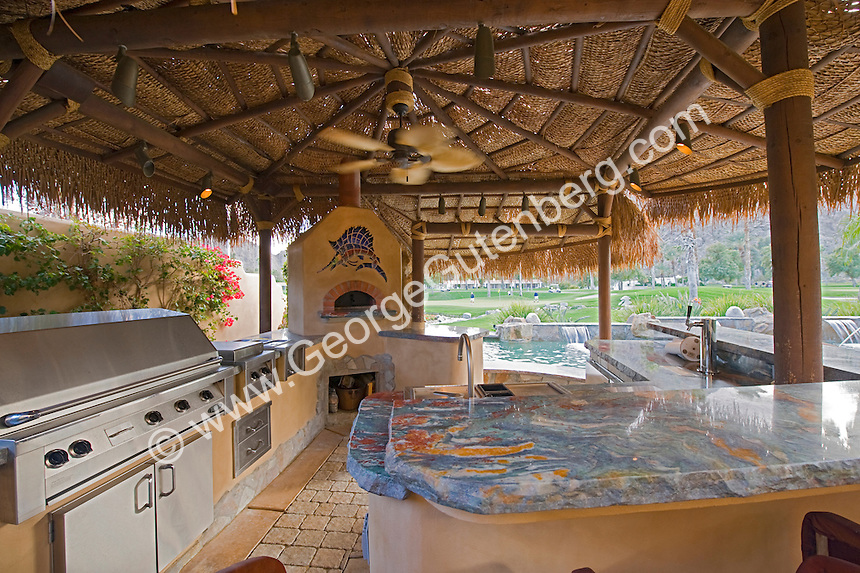 Palapa hut is shown with misting system in luxury backyard