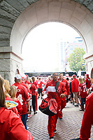 Fans greet the Badgers football team under the Camp Randall Arch during homecoming on Saturday, October 12, 2013 in Madison, Wisconsin