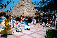 Traditional dancers from Columbia performing dance for tourists..