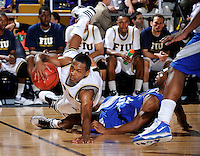 25 February 2010:  FIU's Phil Gary, Jr. (4) is upended by MTSU's James Washington (15) in the second half as the Middle Tennessee Blue Raiders defeated the FIU Golden Panthers, 74-71, at the U.S. Century Bank Arena in Miami, Florida.