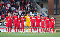 The Orient team during the minute silence in memory of former Orient player Malcom Graham during the Sky Bet League 2 match between Leyton Orient and Wycombe Wanderers at the Matchroom Stadium, London, England on 19 September 2015. Photo by Andy Rowland.