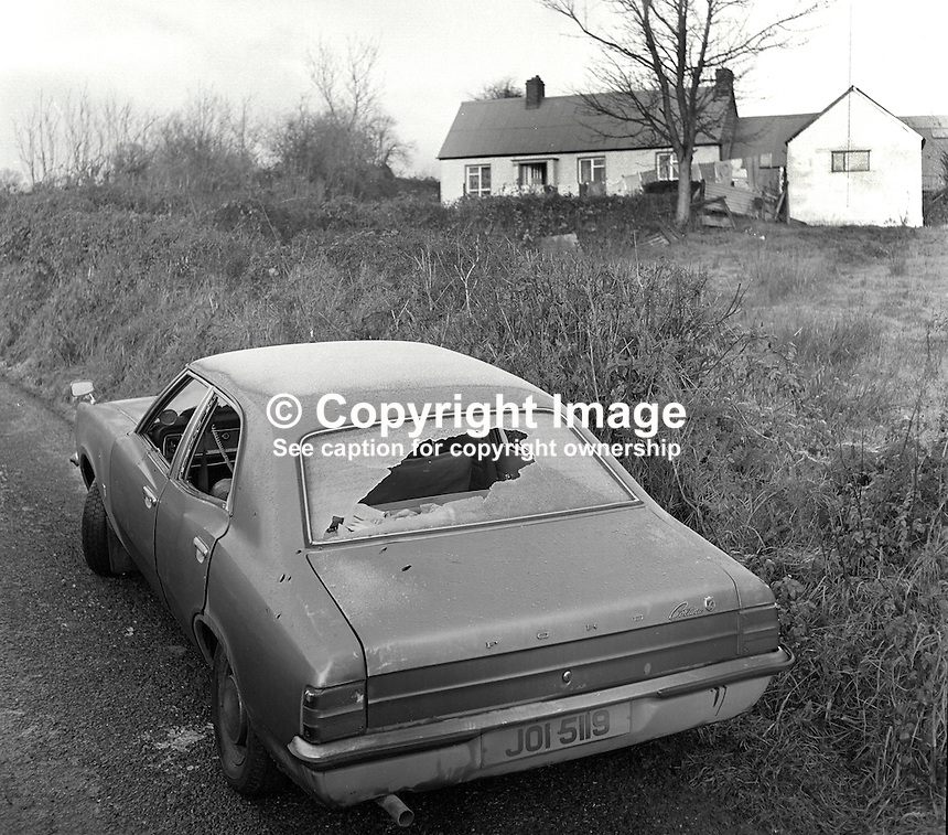 The unmarked police car in which two policemen were shot dead in a Provisional IRA ambush at Clonavaddy, near Pomeroy, Co Tyrone, N Ireland, 25th November 1975. The murdered policemen were Reserve Constable Sam Clarke,Protestant, and Sergeant Patrick Maxwell, Roman Caholic. There were 17 bullet holes in the car and 40 spent AK47 cases at the scene.  The police were on a Good Samaritan mission to deliver news of the death of a relative. The message, originally from the Rep of Ireland  police, was subsequentally found to be bogus. 197511260754A..Copyright Image from Victor Patterson, 54 Dorchester Park, Belfast, UK, BT9 6RJ..Tel: +44 28 9066 1296.Mob: +44 7802 353836.Voicemail +44 20 8816 7153.Skype: victorpattersonbelfast.Email: victorpatterson@me.com.Email: victorpatterson@ireland.com (back-up)..IMPORTANT: If you wish to use this image or any other of my images please go to www.victorpatterson.com and click on the Terms & Conditions. Then contact me by email or phone with the reference number(s) of the image(s) concerned.