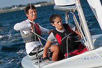 Baillie Lawless,'15, and crew JP Silvestri,'16, work together as they round a marker during practice in the Newport Harbor.