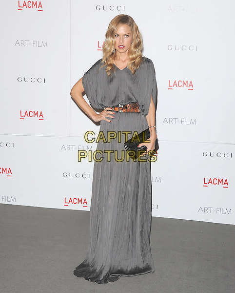 Rachel Zoe.The Inaugural Art and Film Gala held at LACMA in Los Angeles, California, USA..November 5th, 2011   .full length dress hand on hip grey gray wet damp hem belt brown belt black clutch bag  .CAP/RKE/DVS.©DVS/RockinExposures/Capital Pictures.