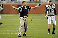 26 December 2010:  FIU Head Football Coach Mario Cristobal celebrates a touchdown as the FIU Golden Panthers defeated the University of Toledo Rockets, 34-32, to win the 2010 Little Caesars Pizza Bowl at Ford Field in Detroit, Michigan.