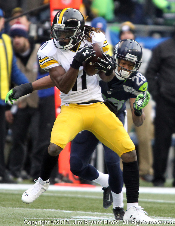 Pittsburgh Steelers wide receiver Markus Wheaton (11) catches a pass in front of Seattle Seahawks cornerback Marcus Bailey (28) at CenturyLink Field in Seattle, Washington on November 29, 2015.  The Seahawks beat the Steelers 39-30.      ©2015. Jim Bryant Photo. All Rights Reserved.
