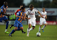 Pictured: Andrea Orlandi of Swansea (R) closely marked by Sean Mcallister of Shrewsbury (L).  Tuesday 23 August 2011<br />