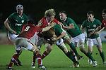 Wales flanker Daniel Thomas stops Ireland number 8 Conor Joyce..Under 20 Six Nations.Wales v Ireland.Eirias - Colwyn Bay.01.02.13.©Steve Pope