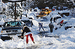 Gazette-Star/122009. Hyattsville residents get out of their houses to shovel their cars out of the snow on Sunday morning, a day after the huge snowfall.