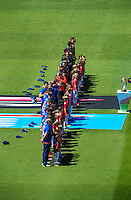 The teams line up for national anthems before the ICC Cricket World Cup one day pool match between the New Zealand Black Caps and England at Wellington Regional Stadium, Wellington, New Zealand on Friday, 20 February 2015. Photo: Dave Lintott / lintottphoto.co.nz