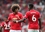 Manchester United's Marouane Fellaini talks to Paul Pogba during the premier league match at Old Trafford Stadium, Manchester. Picture date 13th August 2017. Picture credit should read: David Klein/Sportimage