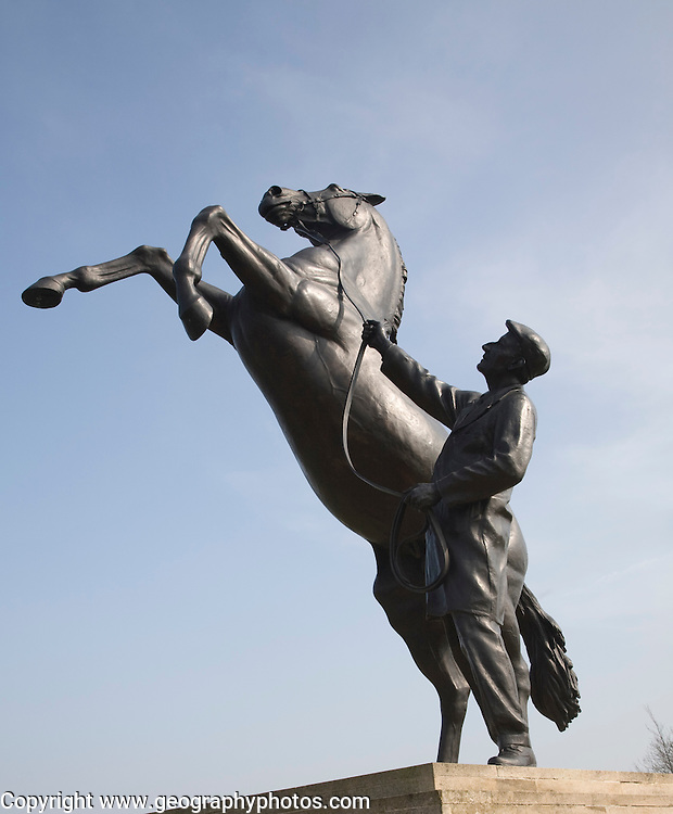 """The Newmarket stallion"" sculpture by Marcia Astor and Allan Sly 2000 near the National Stud, Newmarket, Suffolk, England"