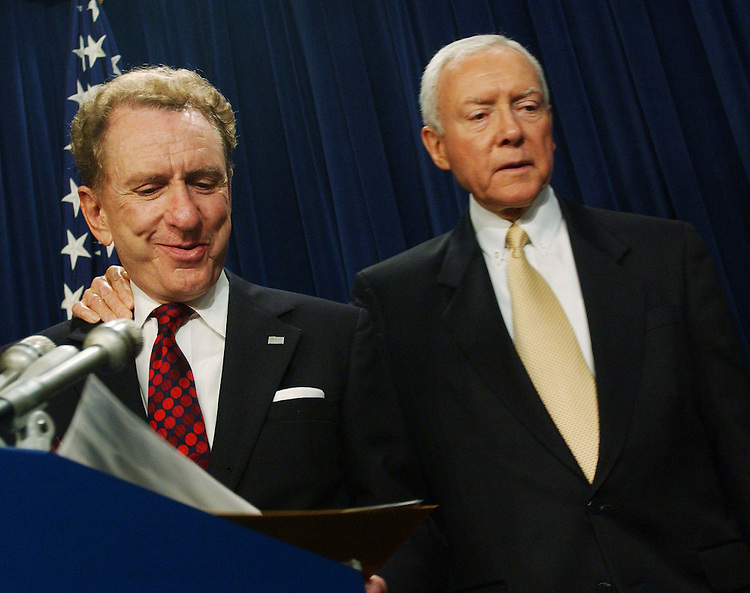 "11/18/04.SPECTER SUPPORT--Outgoing Chairman Orrin G. Hatch, R-Utah, puts his arm around Sen. Arlen Specter, R-Pa., at the end of a news conference in which Senate Judiciary Republicans announced their unanimous support for Specter as their next chairman. From CQ.com: ""We are definitely supporting Arlen Specter for this position,"" said Orrin G. Hatch, R-Utah, who is being forced by six-year GOP term limits to relinquish the chairmanship. ""He will be the chairman of the Senate Judiciary Committee."".Social conservatives have bombarded Senate Republicans with demands that they block Specter from becoming chairman ever since he said Nov. 3 that President Bush would have a difficult time winning confirmation of any Supreme Court nominee who was eager to overturn the landmark 1973 Roe v. Wade decision legalizing abortion nationwide..Though the actual chairmanship vote will not take place until the new Congress convenes in January, Thursday's announcement appears to assure that Specter will survive the conservative onslaught. Committee Republicans have the first vote on the chairmanship, and their recommendation must then be approved by a majority of the 55 Republicans who will serve in the 109th Congress..Flanked by his fellow committee Republicans, Specter read a statement in which he said, ""I have not and would not use a litmus test to confirm nominees."".CONGRESSIONAL QUARTERLY PHOTO BY SCOTT J. FERRELL"