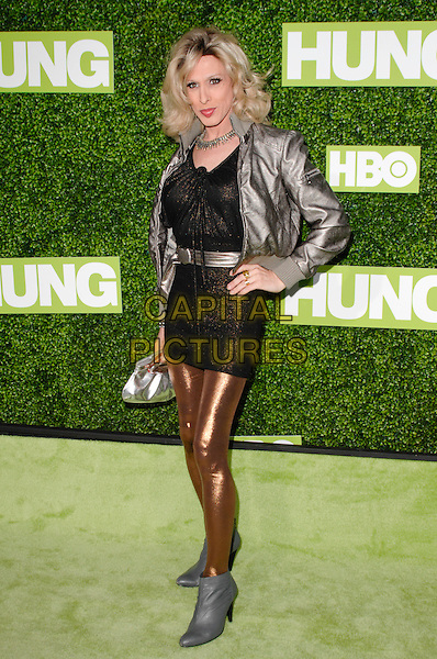 "ALEXIS ARQUETTE.The Premiere Of ""Hung"" held at Paramount Studios, Los Angeles, California, USA. .June 24th, 2009 .full length black dress lace gold bronze leggings grey gray ankle boots jacket silver hand on hip.CAP/ROT.©Lee Roth/Roth Stock/Capital Pictures"