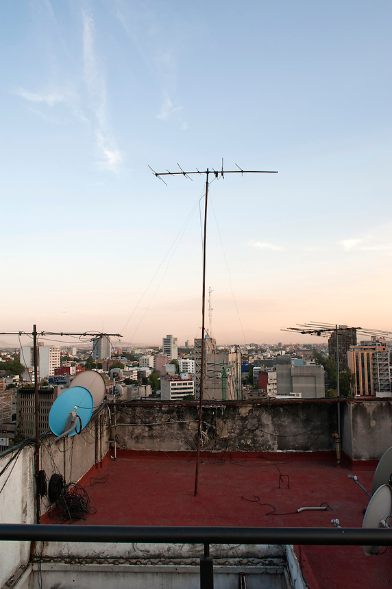 Photo shoot for magazine cover.  Torreblanca on a rooftop in central Mexico City.