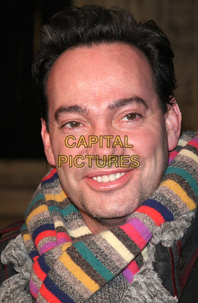 CRAIG REVEL HORWOOD.Attending the Gala VIP Opening Night of Cirque du Soleil's 'Varekai' at the Royal Albert Hall, London, England, UK, .January 5th 2010..arrivals portrait headshot green grey brown multi-coloured smiling pink yellow  striped scarf gray .CAP/ROS.©Steve Ross/Capital Pictures.