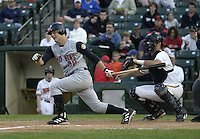 June 1, 2004:  Brant Ust of the Toledo Mudhens hits as catcher Joe Mauer looks on during a game at Frontier Field in Rochester, NY.  The Mudhens are the Triple-A International League affiliate of the Detroit Tigers.  Photo By Mike Janes/Four Seam Images