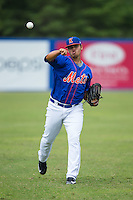Kingsport Mets starting pitcher Darwin Ramos (38) warms up in the outfield prior to the game against the Greeneville Astros at Hunter Wright Stadium on July 7, 2015 in Kingsport, Tennessee.  The Mets defeated the Astros 6-4. (Brian Westerholt/Four Seam Images)