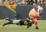 Green Bay Packers cornerback Tramon Williams tries to make an open field tackle of San Francisco 49ers' Anthony Dixon during the fourth quarter of the game at Lambeau Field in Green Bay, Wis., on Dec. 5, 2010.