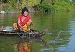 Chan Ran fishes in the Monkol Borey River that runs through her village of Thmar Dat in northern Cambodia. Following devastating 2011 floods, Church World Service and Dan Church Aid, both members of the ACT Alliance, helped villagers to recover their homes and livelihoods.