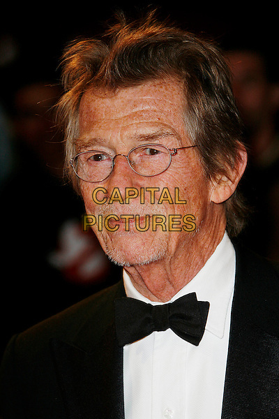 "JOHN HURT .Opening Gala of the 2009 London Film Festival - the World Premiere of ""Fantastic Mr Fox"" at the Odeon, Leicester Square, London, England, UK, October 14th 2009.portrait headshot glasses black bow tie tux tuxedo facial hair goatee .CAP/DAR.©Darwin/Capital Pictures."