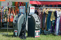 """Cash machines at the AfroPunk Festival in Commodore Barry Park in Brooklyn in New York on Sunday, August 26, 2012. The festival in the neighborhood of Fort Greene bills itself as the """"other black experience"""" and blends the black punk and hardcore punk scenes. There is also a diverse aspect combining other minority groups, all dressed in their fashionable punk ensembles. (© Richard B. Levine)"""