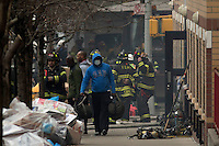 A man exits a building near the scene where a powerful explosion knocked two residential buildings in East Harlem killing 2 people and injuring at least 22 others in New York. March 12, 2014. Photo by Eduardo Munoz Alvarez/VIEW