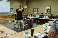 NWA Democrat-Gazette/CHARLIE KAIJO Jake Bradley of U.S. LawShield gives a gun readiness instruction during a Equip 2 Conceal class on Saturday, January 6, 2018 at Cabela's in Rogers. The concealed carry class fulfills the training requirements for a multi-state concealed weapons permit from Arizona that is honored in Arkansas and 30+ other states. About 30 people attended the class which is offered on most weekends. Instructors go through gun safety, public safety, instruction on how to load and unload revolvers and semi automatics and certain amount of state laws.
