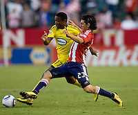 Chivas USA defender Carlos Borja (23) battles Columbus Crew midfielder Emmanuel Ekpo (17) for the ball. CD Chivas USA defeated the Columbus Crew 3-1 at Home Depot Center stadium in Carson, California on Saturday July 31, 2010.