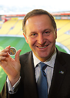 NZ Prime Minister John Key with the Webb Ellis Cup coin. 2011 Rugby World Cup Webb Ellis Cup commemorative coin launch - One Year to Go NZ Business breakfast at Westpac Stadium, Wellington on Thursday, 9 September 2010. Photo: Dave Lintott/lintottphoto.co.nz