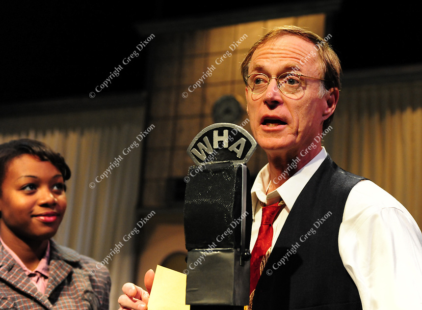 True to life, Norman Gilliland plays a radio announcer in University Theatre's production of War of the Worlds as Jazzmyne Dickins looks on.