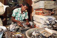 A man sorts through used electronics in a small village near Kolkata.<br /> <br /> To license this image, please contact the National Geographic Creative Collection:<br /> <br /> Image ID: 1925792  <br />  <br /> Email: natgeocreative@ngs.org<br /> <br /> Telephone: 202 857 7537 / Toll Free 800 434 2244<br /> <br /> National Geographic Creative<br /> 1145 17th St NW, Washington DC 20036