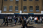 Supporters walking past the East Stand on Worcester Avenue before Tottenham Hotspur took on Watford in an English Premier League match at White Hart Lane. Spurs were due to make an announcement in April 2016 regarding when they would move out of their historic home and relocate to Wembley as their new stadium was completed. Spurs won this match 4-0 watched by a crowd of 31,706, a reduced attendance figure due to the ongoing ground redevelopment.