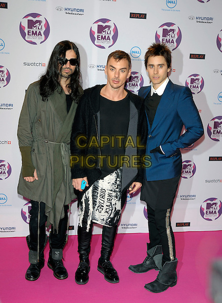 30 Seconds to Mars - Tomo Milicevic, Shannon Leto & Jared Leto.MTV European Music Awards EMA red carpet arrivals, Odyssey Arena, Belfast, Northern Ireland..6th November 2011.full length jeans denim black boots white blue green jacket band group sunglasses shades .CAP/PL.©Phil Loftus/Capital Pictures.