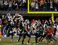 Michigan State Spartans celebrate following the Big Ten Championship football game at Lucas Oil Stadium in Indianapolis on Friday, December 7, 2013. (Columbus Dispatch photo by Jonathan Quilter)