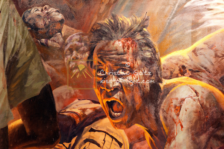 Detail of a painting on display at the Independence Museum depicting the struggle for independence. The mural bears the signature of a Chinese artist.